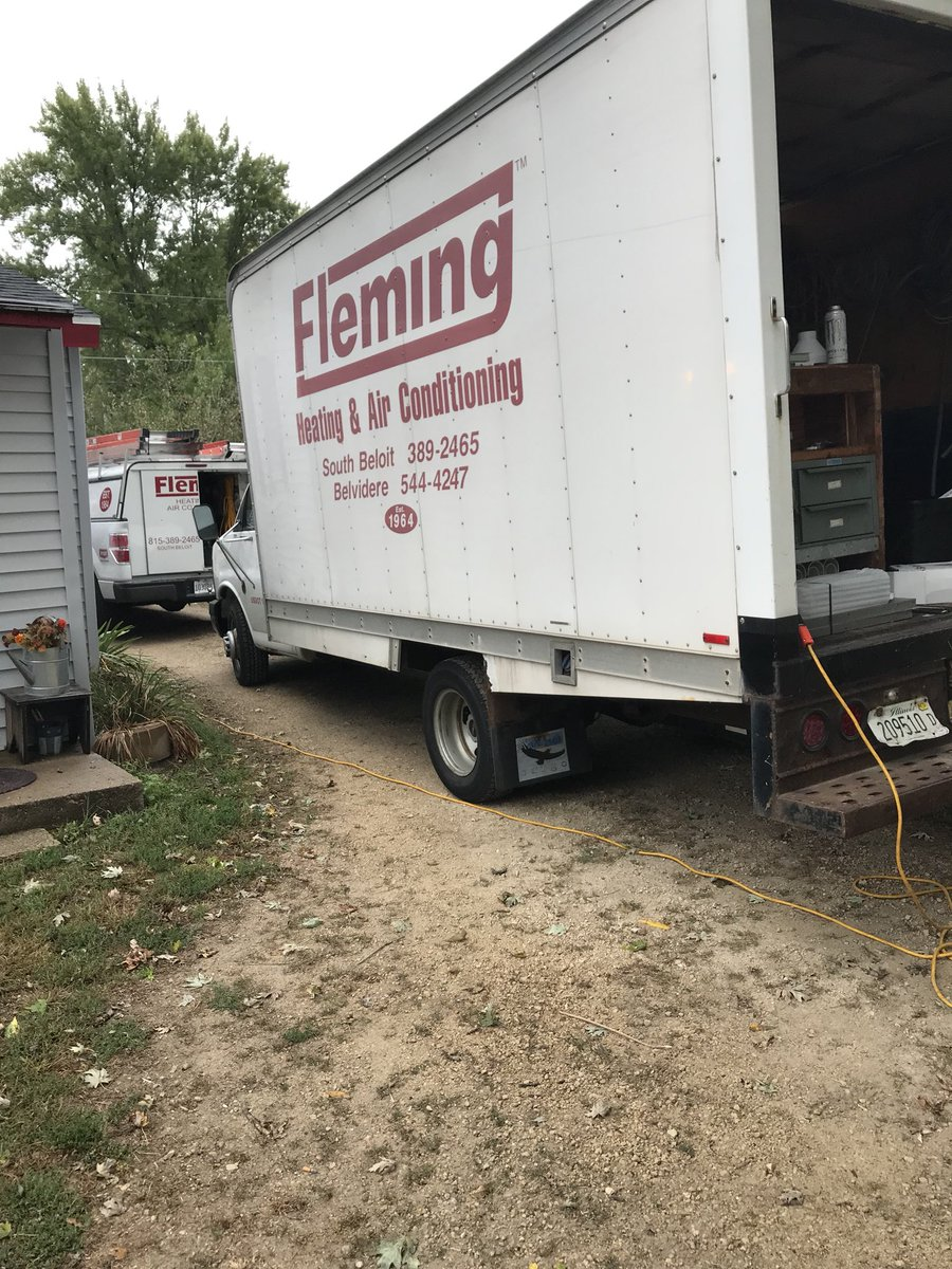 Fleming Heating & Air Conditioning Inc. trucks